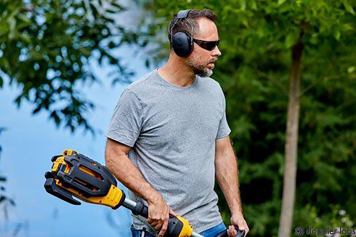 3M worktunes industrial headphones action shot - guy with weedeater